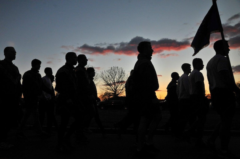 Airmen assigned to the 70th Intelligence, Surveillance and Reconnaissance Wing march in formation to the starting line as part of the 2016 Sexual Assault, Awareness and Prevention Month garrison run April 8, 2016 at Fort George G. Meade, Md. There were over 1,900 joint service members participating in the SAAPM event. (U.S. Air Force photo/Staff Sgt. Alexandre Montes)