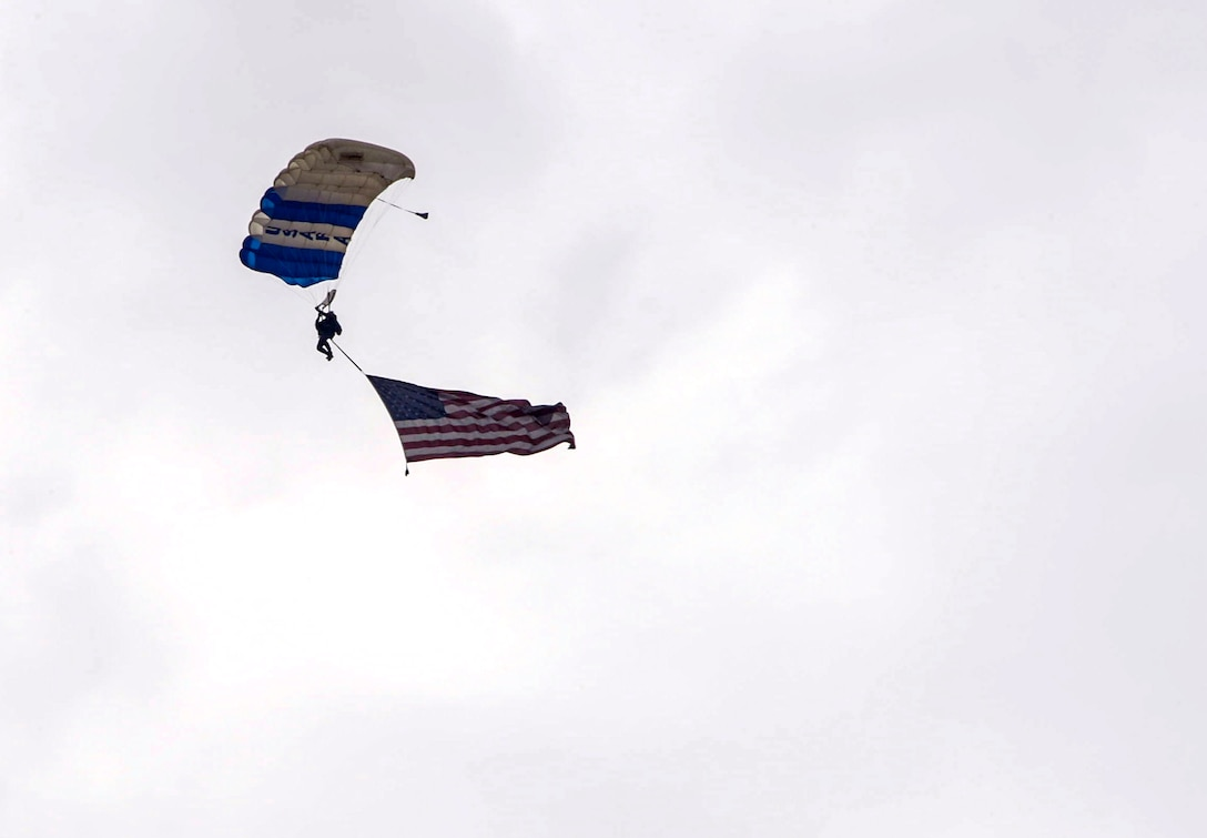 Members from the U.S. Air Force skydiving team, Wings of Blue, perform over the 2016 International Air and Space Fair (FIDAE) in Santiago, Chile, April 1, 2016. During FIDAE, U.S. Airmen participated in in several subject matter expert exchanges with their Chilean counterparts and also hosted static displays and aerial demonstrations to support the air show.  (U.S. Air Force photo by Tech. Sgt. Heather Redman/Released)