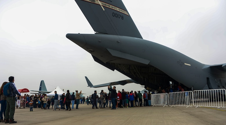 Hundreds of people gather to tour the C-17 Globemaster III, from Wright-Patterson AFB, Ohio, at the 2016 International Air and Space Fair (FIDAE) in Santiago, Chile April 2, 2016.  Airmen from around the U.S. are scheduled to participate in a variety of activities during the week-long air show that includes aerial demonstrations, interaction with the local community, and subject matter expert exchanges with the Chilean air force. (U.S. Air Force photo by Tech. Sgt. Heather Redman/Released)
