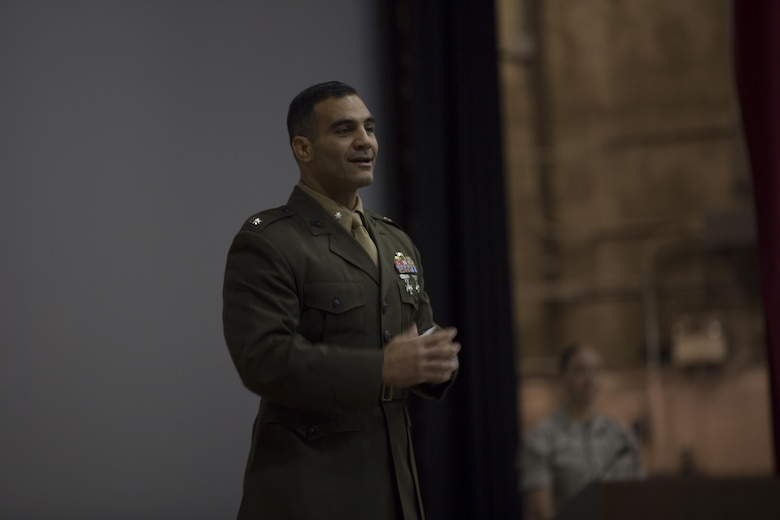 Lt. Col. Speros Koumparakis, commanding officer, Communication Training Battalion, addresses the crowd during the Basic Communications Officer Course 1-16 graduation at the base theater April 1, 2016. (Official Marine Corps Photo by Cpl. Julio McGraw/Released)