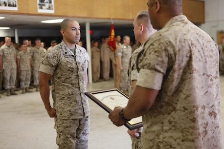 Tucson, Ariz.-Native Luis A. Ochoa, an embarker with Chemical Biological Incident Response Force is promoted to the rank of staff sergeant during a ceremony at Chemical Biological Incident Response Force (CBIRF) headquarters aboard Naval Support Facility Indian Head, Md., April 4, 2016. When directed, CBIRF forward-deploys and/or responds with minimal warning to a chemical, biological, radiological, nuclear and high yield explosive (CBRNE) threat or event in order to assist local, state, or federal agencies and the geographic combatant commanders in the conduct of CBRNE response or consequence management operations, providing capabilities for command and control; agent detection and identification; search, rescue, and decontamination; and emergency medical care for contaminated personnel. (Official USMC Photos by Sgt. Jonathan Herrera)