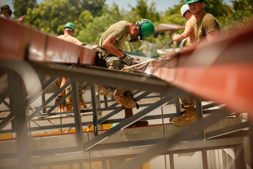 Marine Corps Lance Cpl. Marco Rodriguez, an engineer assigned to the 9th Engineer Support Battalion, welds and prepares metal framing, April 2, 2016, at San Nicolas Elementary School in Capiz, Philippines, as part of a humanitarian civic assistance project during Exercise Balikatan 2016. The construction project is one of several taking place during this year's exercise. Marine Corps photo by Cpl. Hilda M. Becerra