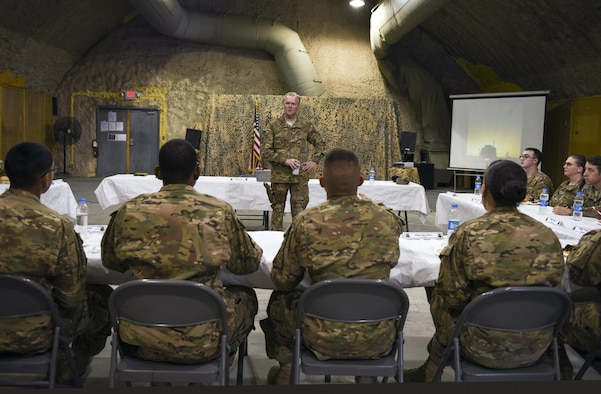 Chief Master Sgt. of the Air Force James A. Cody addresses concerns from junior enlisted Airmen assigned to the 451st Air Expeditionary Group at Kandahar Airfield, Afghanistan, April 6, 2016. During his trip, Cody engaged with Airmen deployed to Afghanistan in support of the NATO Resolute Support mission and Operation Freedom's Sentinel through a series of Q&A format all calls, small group discussions and personal site visits. (U.S. Air Force photo/Tech. Sgt. Nicholas Rau)