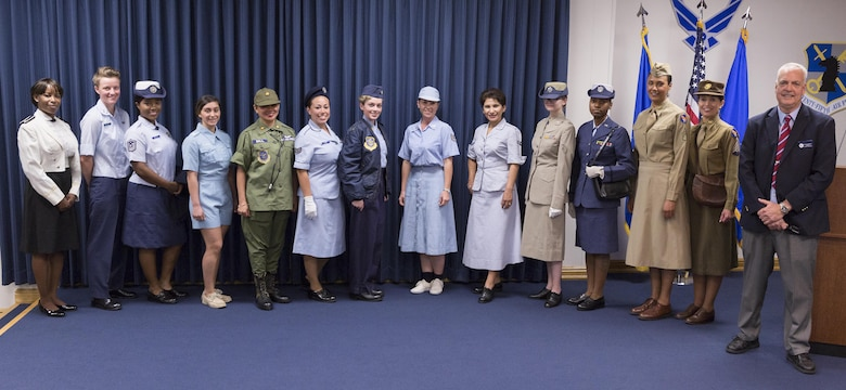 Lt. Col. (retired) David Shultz, right, stands with the 25 AF volunteers who modeled U.S. Air Force women's vintage uniforms during the Women's History Month event March 28. Shultz owns and curates the uniforms as part of his Air Force heritage exhibit, some of which is displayed at the Texas Air Museum on Stinson Field, San Antonio, Texas. (U.S. Air Force Photo/Guido Locati, 25 AF/PA)
