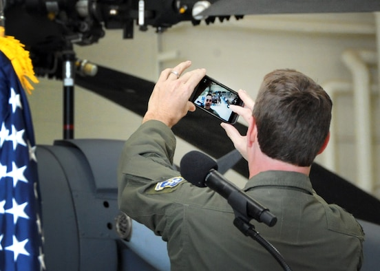 Lt. Col. Andrew Meshel, the newly-appointed 305th Rescue Squadron commander, snaps a selfie with the unit during the assumption of command ceremony at the 943rd Maintenance Squadron hangar at Davis-Monthan Air Force Base, Ariz., April 3. (U.S. Air Force photo/Tech. Sgt. Carolyn Herrick)