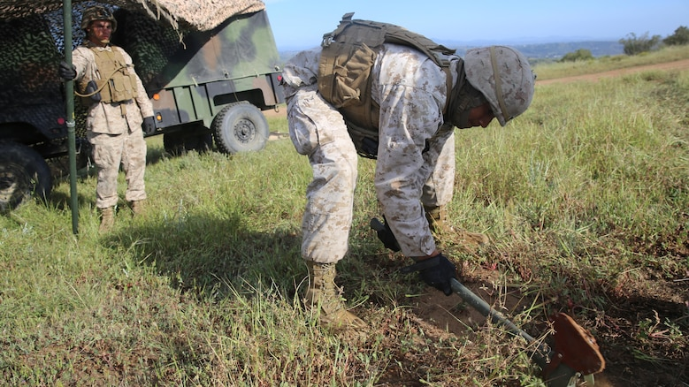 Marines with Battery Q, 5th Battalion, 11th Marine Regiment, I Marine Expeditionary Force, set up camouflage netting during Spring Fire Exercise at Marine Corps Base Camp Pendleton March 31, 2016. During the combined-arms training evolution, each battalion moved to different locations on a frequent basis in order to simulate positions they would hold based on specific situations, setting up and breaking down their outposts as quickly as possible.