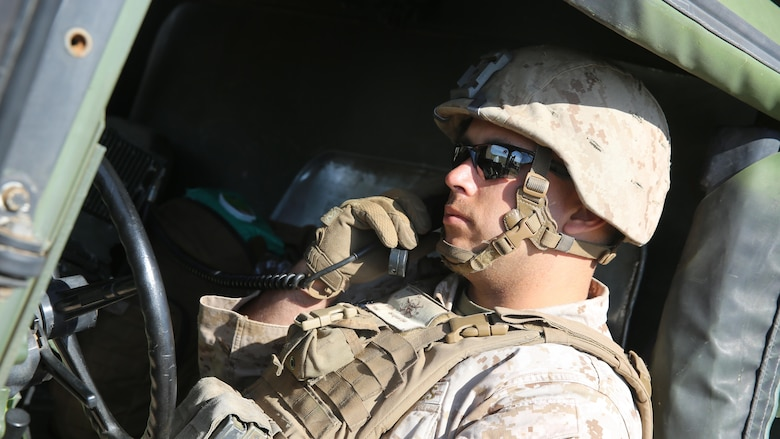 A Marine with Battery Q, 5th Battalion, 11th Marine Regiment, I Marine Expeditionary Force, tests high frequency communications during Spring Fire Exercise at Marine Corps Base Camp Pendleton, California, March 31, 2016. During the combined arms training exercise, Marines used high frequency communications, which utilizes satellites, to communicate with command centers from miles away.