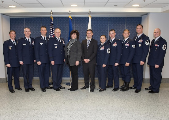 Air Force Chief of Staff Gen. Mark. A Welsh III and Janine Rozina pose for a photo with the 2014 and 2015 Lance P. Sijan Leadership Award winners following the award ceremony at the Pentagon in Washington, D.C., April 7, 2016. Rozina is Sijan's sister. Each year, the award is given to a senior and junior officer and a senior and junior enlisted member who demonstrated outstanding leadership abilities. The 2014 winners are: Lt. Col. Stephen Matthews, Capt. John Sullivan, Master Sgt. Janell McGivern and Senior Airman Tristen Windel. The winners for 2015 are: Maj. Patrick Kolesiak, Capt. David Plachno, Senior Master Sgt. Justin Deisch and Tech. Sgt. Kevin Henderson. (U.S. Air Force photo/Jim Varhegyi)