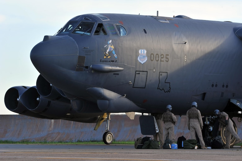 Aircrew load gear and supplies into their B-52 Stratofortress prior to departure from Barksdale Air Force Base, La., April 8. Several B-52s deployed to Al Udeid Air Base, Qatar, in support of ongoing operations in U.S. Central Command's area of responsibility. This is the first time B-52s have been based in the area since conducting missions out of Saudi Arabia during Operation Desert Storm in 1991. (U.S. Air Force photo/Senior Airman Joseph Raatz)