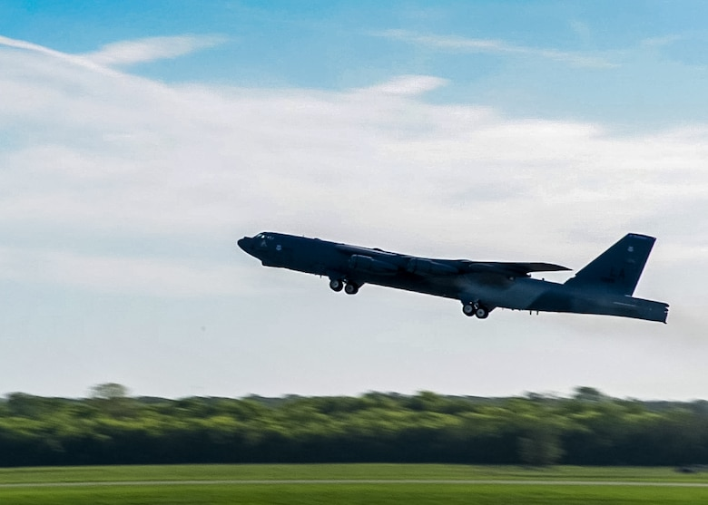 A B-52 Stratofortress takes off from Barksdale Air Force Base, La., April 8, en route to Al Udeid Air Base, Qatar. Several B-52s deployed to Qatar in support of ongoing operations in U.S. Central Command's area of responsibility, including eliminating the ISIL terrorist group and the threat they pose to Iraq, Syria and the wider international community. This deployment assists in satisfying manned strike requirements for continued operations in the area. (U.S. Air Force photo/Senior Airman Joseph Raatz)