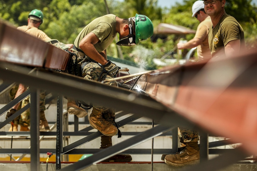 Marine Corps Lance Cpl. Marco Rodriguez welds and prepares metal framing.