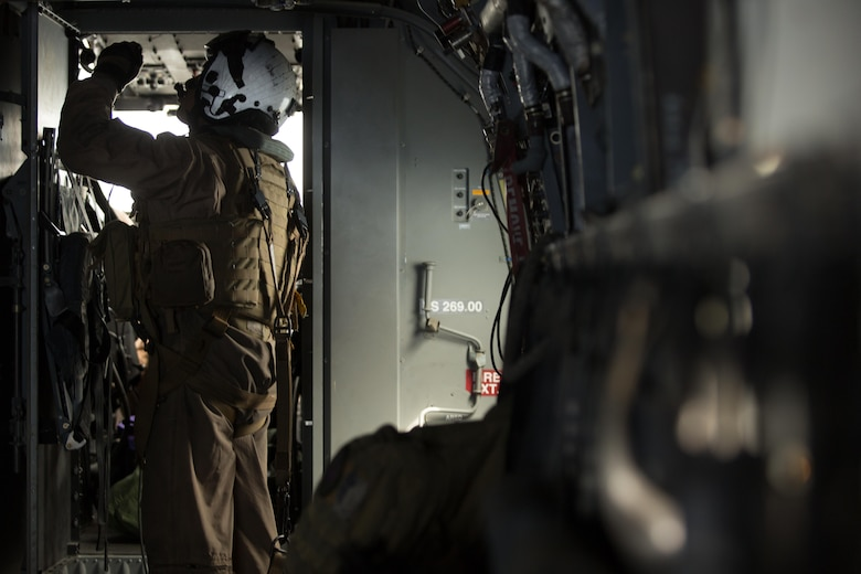 "Cpl. Jesus Ontiveros, a crew chief with Marine Medium Tiltrotor Squadron (VMM) 364 ""Purple Foxes,"" and an Oxnard, California, native, observes a panel aboard an MV-22B Osprey during a flight above Southern California, April 5. Marines with VMM-364 and VMM-165 conducted division confined area landings to build and maintain the pilots' and air crew's proficiency in performing the landings. (U.S. Marine Corps photo by Sgt. Lillian Stephens/Released)"