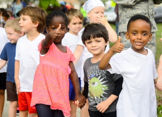 Children from the Child Development Center (CDC) at MacDill Air Force Base, Fla., give a thumbs up prior to participating in the first ever CDC Color Run, April 1, 2016. April is Month of the Military Child, which recognizes the challenges and sacrifices that military children make as their parents serve. (U.S. Air Force photo by Staff Sgt. Melanie Hutto)