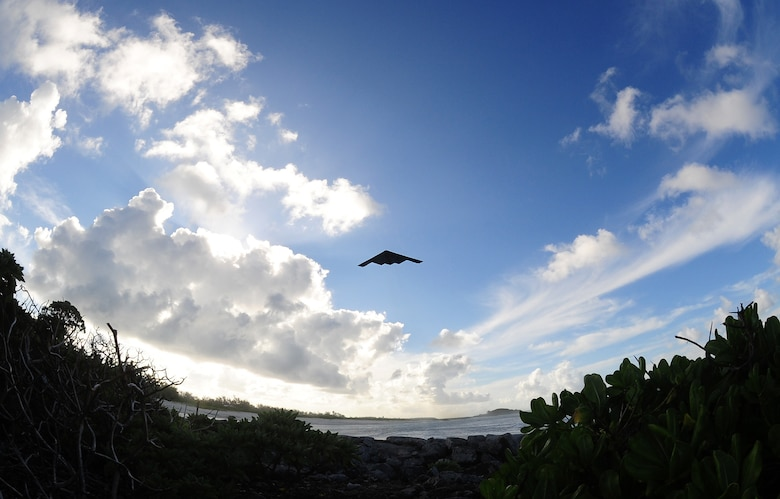 A U.S. Air Force B-2 Spirit bomber, deployed from Whiteman Air Force Base, Mo., takes off, March 27, 2016, in the U.S. Pacific Command area of operations . Bomber operations provide a visible demonstration of the U.S. Air Force's ability to project power globally and respond to any potential crisis or challenge. (U.S. Air Force photo by Senior Airman Joel Pfiester/Released)