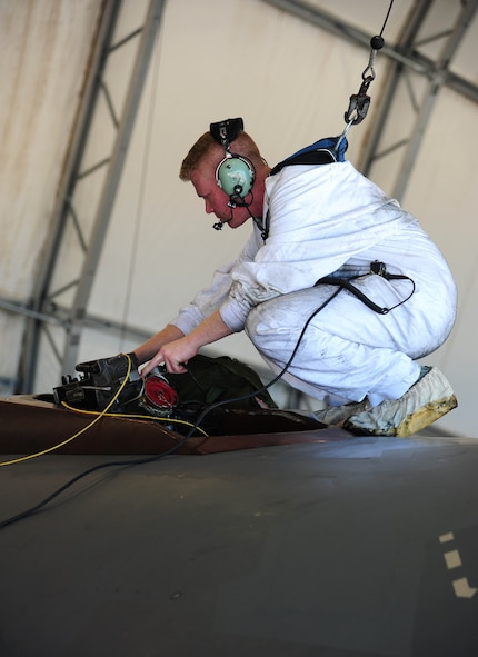 U.S. Air Force Staff Sgt. Dillon Cody, an aircraft fuel systems technician with the 509th Aircraft Maintenance Squadron, performs an aerial-refueling operational check on a U.S. Air Force B-2 Spirit bomber, March 13, 2016, in the U.S. Pacific Command area of operations. Bomber training missions and deployments ensure crews maintain a heightened state of readiness to demonstrate their ability to provide an always-ready global strike capability. (U.S. Air Force photo by Senior Airman Joel Pfiester/Released)