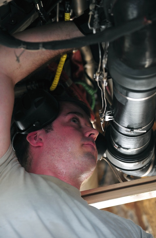 U.S. Air Force Staff Sgt. James Torrance, an electrical and environmental systems technician with the 131st Aircraft Maintenance Squadron, performs maintenance on a U.S. Air Force B-2 Spirit bomber, March 11, 2016, in the U.S. Pacific Command area of operations. These deployments help maintain global stability and security while enabling aircrew to become familiar with operating in different regions. (U.S. Air Force photo by Senior Airman Joel Pfiester/Released)