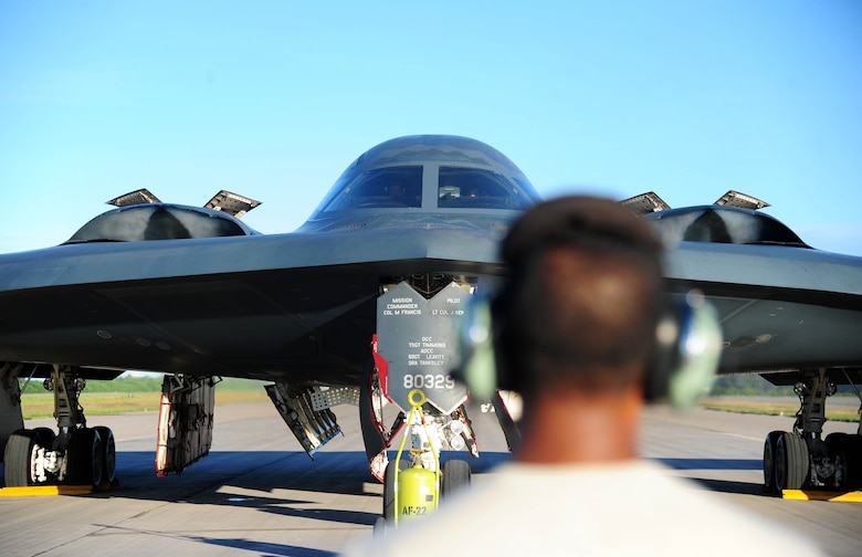 U.S. Air Force Senior Airman Hirantha De Mel, a crew chief with the 509th Aircraft Maintenance Squadron, watches a U.S. Air Force B-2 Spirit bomber perform an engine run, March 11, 2016, in the U.S. Pacific Command area of operations. Strategic Command bombers regularly deploy to the Indo-Asia-Pacific region to conduct PACOM-led operations which provide leaders deterrence options to maintain regional stability. (U.S. Air Force photo by Senior Airman Joel Pfiester/Released)