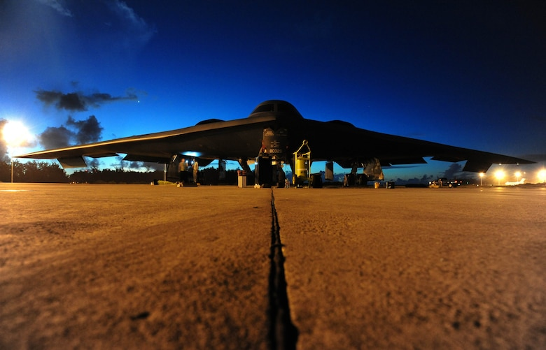 Crew chiefs with the 393rd Aircraft Maintenance Unit prepare to tow a U.S. Air Force B-2 Spirit bomber, March 11, 2016, in the U.S. Pacific Command area of operations. Bomber training missions and deployments ensure crews maintain a high state of readiness and proficiency and demonstrate the ability to provide an always-ready global strike capability. (U.S. Air Force photo by Senior Airman Joel Pfiester/Released)