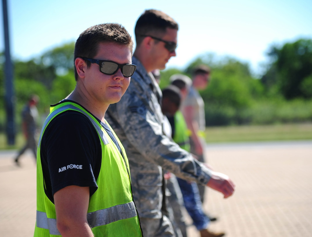 U.S. Air Force Airmen from Whiteman Air Force Base, Missouri, and the Royal Australian Air Force perform a foreign object debris walk at RAAF Base Tindal, Australia, March 22, 2016. The FOD walk was conducted during a training mission where a B-2 Spirit conducted an engine running crew change at the base. The B-2 was one of three that were deployed to the Indo-Asia-Pacific region from March 8 through 29 to enhance bomber crew readiness and proficiency and to integrate capabilities with key regional partners. U.S. Strategic Command bombers regularly rotate through the Indo-Asia-Pacific region to conduct theater security cooperation engagements with U.S. allies and partners and demonstrate a shared commitment to promoting security and stability in the region. (U.S. Air Force photo by Senior Airman Joel Pfiester/ Released)