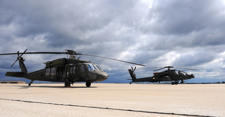 A Missouri Army National Guard UH-60 Black Hawk utility helicopter, left, sits next to an AH-64 Apache attack helicopter on the flightline at Whiteman Air Force Base, Mo., April 1, 2016. Black Hawk helicopters began arriving at the 1-135th Attack Reconnaissance Battalion in September of 2015 as part of the Department of the Army's Aviation Reconstruction Initiative. There are now 13 Apaches and 10 Black Hawks assigned to the unit. (U.S. Air Force photo by Airman 1st Class Michaela R. Slanchik)
