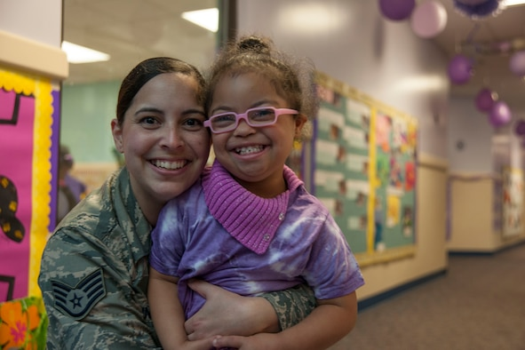 Staff Sgt. Yinell Covington, 779th Dental Squadron dental assistant, and her daughter, Maya Rosario, pose for a picture at a school parade at the Joint Base Andrews Child Development Center Three April 7, 2016. The parade kicks off Month of the Military Child, a time to honor military youth for the important role they play in contributing to the strength of the military family. (U.S. Air Force photo by Airman 1st Class Rustie Kramer/Released)