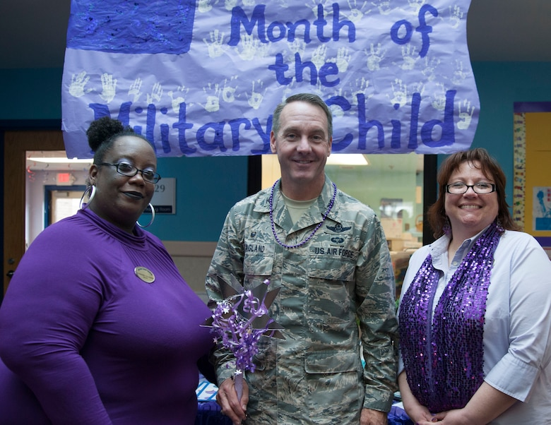 "Chandre Coleman, JBA Child Development Center Three director, Col. Bradley Hoagland, 11th Wing and Joint Base Andrews commander, and Sharon Iniarte, JBA CDC Three assistant director, pose for a picture at a ""purple"" parade at JBA CDC Three April 7, 106. The parade kicks off Month of the Military Child, a time to honor military youth for the important role they play in contributing to the strength of the military family. (U.S. Air Force photo by Airman 1st Class Rustie Kramer/Released)"