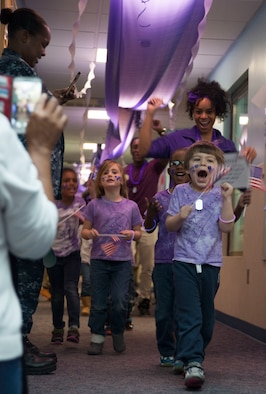 "Students and staff of the Joint Base Andrews Child Development Center Three march in a ""purple"" parade April 7, 2016. The parade kicked off Month of the Military Child celebration, a time to honor military youth for the important role they play in contributing to the strength of the military family. (U.S. Air Force photo by Airman 1st Class Rustie Kramer/Released)"