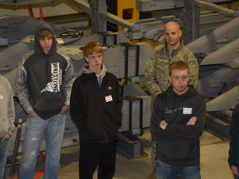 SIOUX FALLS, S.D. - Beresford, S.D. High School juniors, Lathen Norling and Tim Peterson, listen with other high school students as a weapons technician explains his career in the South Dakota Air National Guard during Career Day at Joe Foss Field, S.D. April 6, 2016.  Also pictured is Tim Peterson's father, Master Sgt. Gregory Peterson, 114th Security Forces Squadron flight sergeant, who was present on the tour with Tim. (U.S. Air National Guard photo by Senior Master Sgt. Nancy Ausland/Released)