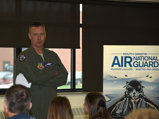 SIOUX FALLS, S.D. - Col. Nate Alholinna, 114th Fighter Wing vice commander, speaks to students and their parents during Career Day held at Joe Foss Field, S.D. April 6, 2016.  Twice a year, the South Dakota Air National Guard recruiters invite young adults and their parents to the base for a chance to learn more about the career opportunities available to them and to speak directly with unit members about their experiences. (U.S. Air National Guard photo by Senior Master Sgt. Nancy Ausland/Released)