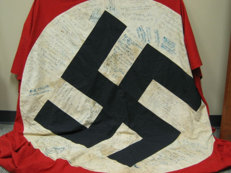 The Moosburg POW flag, which flew over the city hall in Moosburg, Germany, before it was replaced by General Patton's troops with the American flag in late April, 1945. It was signed by more than 100 former POWs, including Luther P. Canup. (Courtesy 303rd Bomb Group Association)