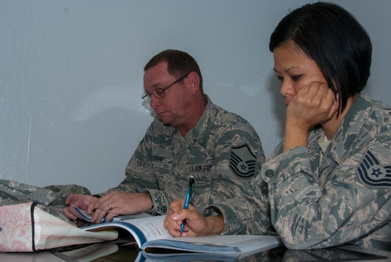 Tech. Sgt. Glory Bilang and Master Sgt. Don Lauver from the Arizona Air National Guard's 162nd Wing, located at the Tucson international Airport attended Financial Peace University here Jan. 27-March 30. The program teaches participants about the basic principles of budgeting, money management and better spending habits. (U.S. Air National Guard photo by Staff Sgt. Micah Hill/Released)