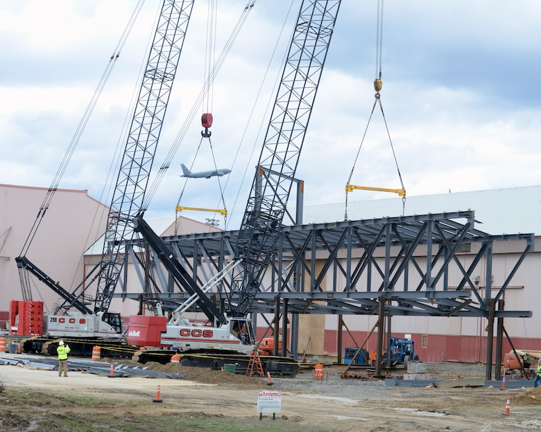 Contractors lift an 80 ton truss into position, Pease Air National Guard Base, N.H., April 8, 2016.  The intent of the construction project is to remodel Buildings 253 and 254 to maximize the operational space in order to promote efficiency and productivity in preparation for the arrival of 12 KC-46A tankers in February 2018. (U.S. Air National Guard photo by Staff Sgt. Curtis J. Lenz)