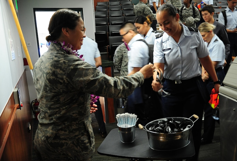"U.S. Air Force 2nd Lt. Allyssa Schimmoeller, 15th Wing alternative Sexual Assault Response coordinator, offers Air Force Reserve Officer Training Corps cadets of Detachment 175 Sexual Assault Awareness and Prevention Month tokens after a documentary viewing and discussion at The University of Hawaii, April 7, 2016. The cadets watched the 2015 documentary ""The Hunting Ground,"" and talked about the realities of sexual assault on college campuses and in the military. (U.S. Air Force photo by 2nd Lt. Kaitlin Daddona/Released)"