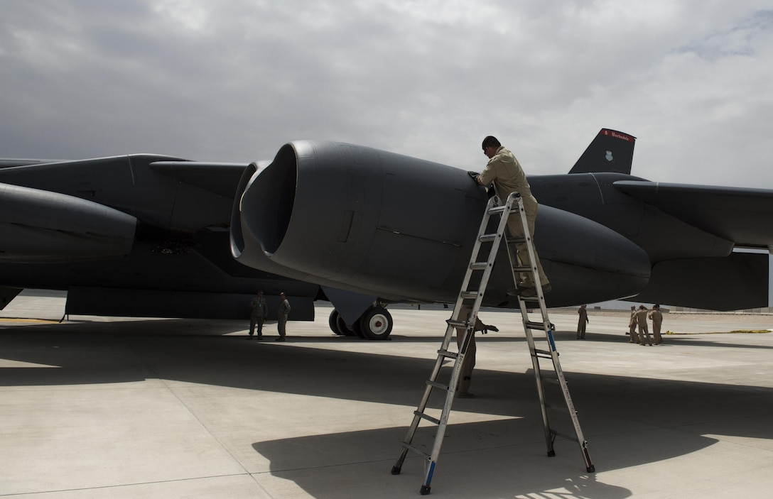 Tech. Sgt. Walter, assigned to the 36th Expeditionary Aircraft Maintenance Squadron at Barksdale Air Force Base, La., inspects a B-52 Stratofortress that arrived at Al Udeid Air Base, Qatar, April 9, 2016, to support Operation Inherent Resolve. The 19-nation air coalition consists of numerous precision strike aircraft and the B-52s will bring their unique capabilities to the fight against The Islamic State of Iraq and the Levant. The B-52 is a long-range heavy bomber that can perform a variety of missions including strategic attack, close-air support, air interdiction and maritime operations. (U.S. Air Force photo/Tech. Sgt. Nathan Lipscomb)