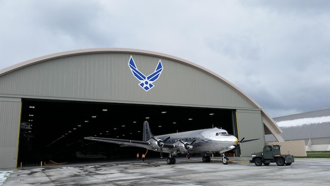 DAYTON, Ohio -- The VC-54C Sacred Cow being towed into the fourth building at the National Museum of the United States Air Force on April 9, 2016. (U.S. Air Force photo by Rob Bardua)