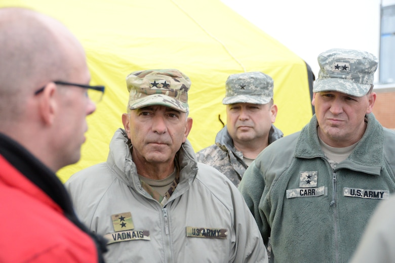 U.S. Army Major General Courtney P. Carr, right, The Adjutant General of Indiana, and U.S. Army Major General Gregory J. Vadnais, center, The Adjutant General and the Director of Military and Veterans Affairs for Michigan, meet with Chris Rosser, left, Medical Control/Trauma Program Manager at Munson Healthcare Grayling Hospital, as they are shown the medical capabilities of the hospital, as well as the 19th CBRNE Enhanced Response Force Package in Grayling, Mich., April 6, 2016. (U.S. Air National Guard photo by Airman 1st Class Kevin D. Schulze)
