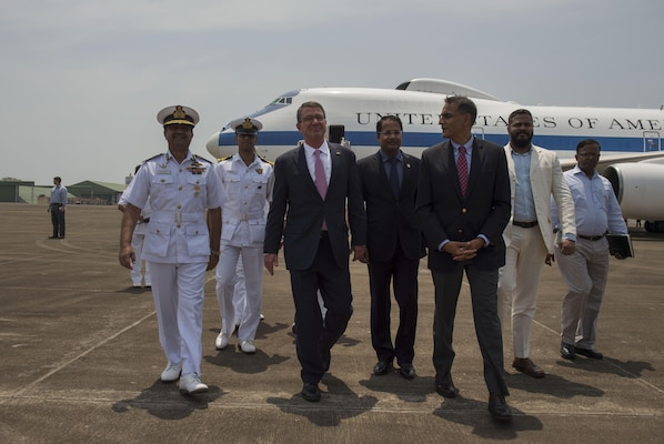 Defense Secretary Ash Carter, left, walks with U.S. Ambassador to India Richard Verma, right, as he arrives in Goa, India, April 10, 2016. Carter is visiting India and the Philippines to solidify the U.S. rebalance to the Asia-Pacific region. DoD photo by Air Force Senior Master Sgt. Adrian Cadiz
