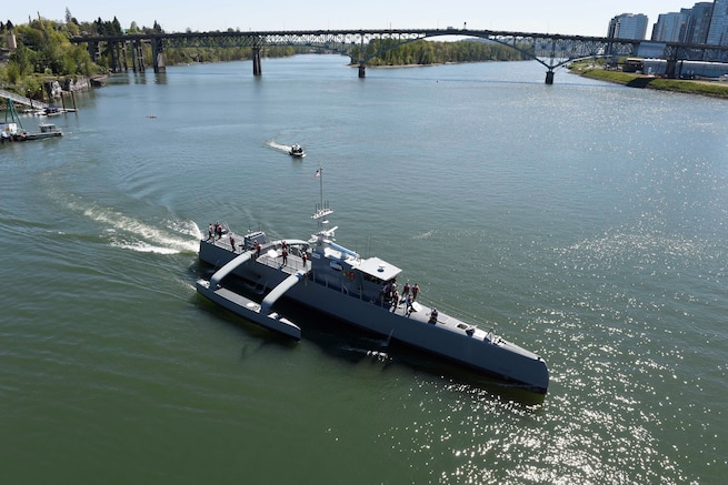 Sea Hunter, a new class of unmanned ocean-going vessel gets underway on the Williamette River, Portland, Ore., April 7, 2017, following a christening ceremony attended by Deputy Defense Secretary Bob Work. The vessel is part the of the Defense Advanced Research Projects Agency's Anti-Submarine Warfare Continuous Trail Unmanned Vessel program.  Navy photo by John F. Williams