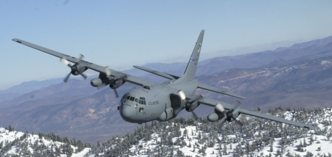 This file photo shows a 152nd Airlift Wing C-130 flying over the Sierra mountain range near Lake Tahoe. 152nd Airlift Wing photo