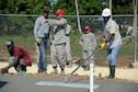 Capt. Joseph Miller, 820th RED HORSE Squadron, quality control officer in charge, coordinates with a local contractor to make adjustments to a new concrete foundation for a clinic being built in Copeyito, Dominican Republic as part of Exercise NEW HORIZONS 2016, Apr. 7, 2016. NEW HORIZONS gives U.S. military members the opportunity to deploy, operate, and re-deploy while including the added benefit of working with and learning from our international partners. (U.S. Air Force photo by Master Sgt. Chenzira Mallory/Released)