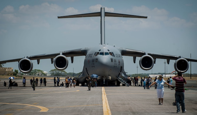 "Locals take photos of a U.S. Air Force C-17 Globemaster III assigned to the 15th Wing, Hickam Air force Base, Hawaii during a static display at Clark Air Base, Philippines, April 9, 2016. U.S. military and Armed Forces of the Philippines hosted the event displaying various aircraft from all U.S. services and the Philippine Air Force. This year marks the 32nd iteration of Balikatan where U.S. service members continue to work ""shoulder-to-shoulder"" with members of the Armed Forces of the Philippines to increase combined readiness to crises and conflict across the Indo-Asia-Pacific region. (U.S. Air Force photo by Tech. Sgt. Araceli Alarcon/Released)"