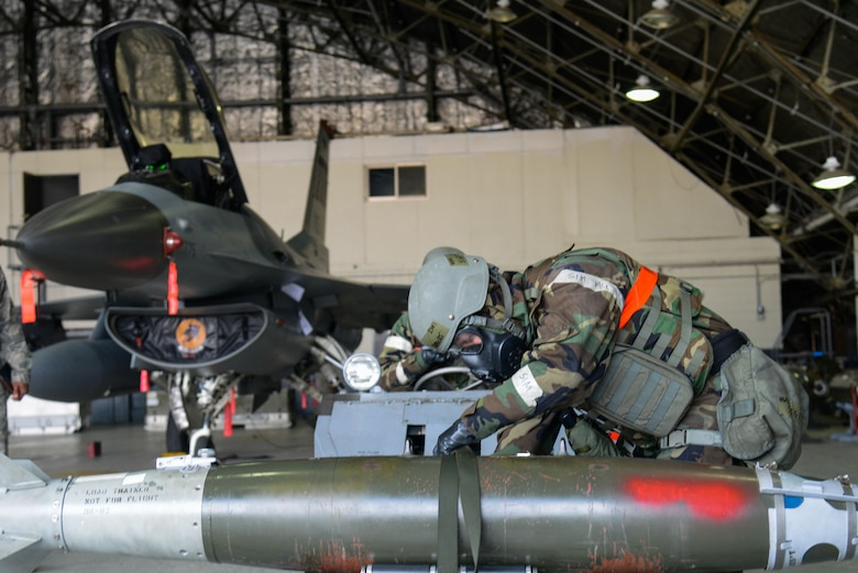 Staff Sgt. Robert Olsen, 36th Aircraft Maintenance Unit, prepares a Mark 82 training bomb to load onto an F-16 Fighting Falcon during a quarterly weapons load competition April 8, 2016, at Osan Air Base, Republic of Korea. Weapons load teams from the 25th and 36th AMUs competed by loading three training bombs and one missile onto their respective aircraft during the event.  (U.S. Air Force photo by Senior Airman Dillian Bamman/Released)