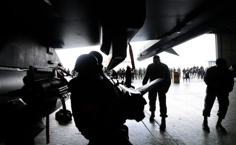 Airmen from the 36th Aircraft Maintenance Unit load an AIM-9 Sidewinder onto an F-16 Fighting Falcon during a quarterly weapons load competition April 8, 2016, at Osan Air Base, Republic of Korea. Weapons load teams from the 25th and 36th AMUs competed by loading three training bombs and one missile onto their respective aircraft during the event. (U.S. Air Force photo by Senior Airman Dillian Bamman/Released)