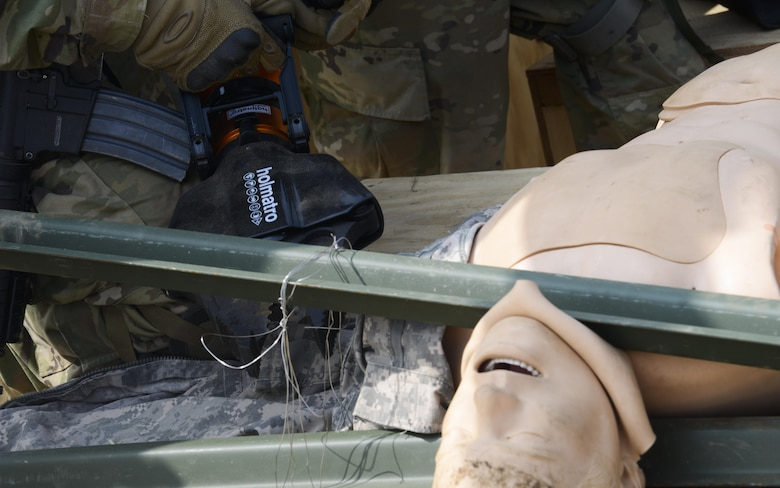 A U.S. Army Joint Security Area Security Battalion fire team member uses the Jaws of Life to rescue a simulated trapped service member during a joint search and recovery exercise April 8, 2016, at Camp Bonifas, Republic of Korea. The Jaws of Life is a hydraulic device that is used to pry apart the wreckage of crashed vehicles or aircraft to free people trapped inside. 51st Civil Engineer Squadron fire prevention firefighters assisted in the exercise by teaching ROK and U.S. Soldiers how to safely enter a crashed aircraft to rescue individuals. (U.S. Air Force photo by Senior Airman Dillian Bamman/Released)