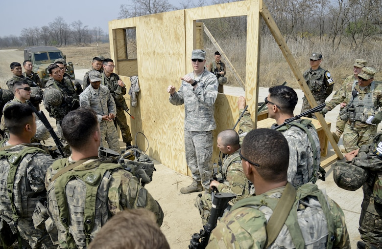 U.S. Air Force Staff Sgt. Eric Gayoso, center, 51st Civil Engineer Squadron fire prevention crew chief, briefs members of the Joint Security Area Security Battalion on aircraft extraction techniques during a joint search and recovery exercise April 8, 2016, at Camp Bonifas, Republic of Korea. The firefighters assisted with the exercise by teaching ROK and U.S. Soldiers on how to enter crashed aircraft by cutting through with specialized equipment such as a circular saw and Jaws of Life. (U.S. Air Force photo by Senior Airman Dillian Bamman/Released)