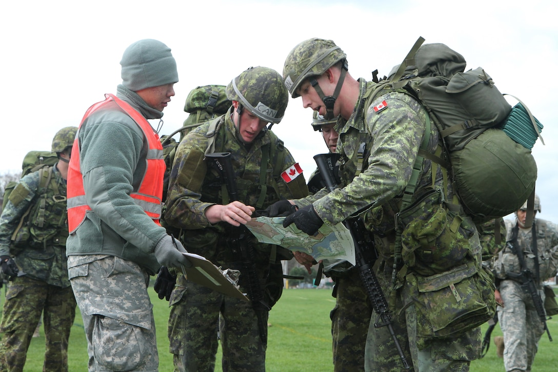 Officer Cadets of the Royal Military College of Canada brief a United States Military Academy (USMA) Cadet scorekeeper on where their next checkpoint will be during the annual Sandhurst Competition held at the United States Military Academy Apr. 8-9, 2016. The Sandhurst Competition is an annual event held at the United States Military Academy (USMA) where the cadets of  military academies from around the world compete in a variety of Soldier skills in which Non-Commissioned Officers of Companies A and B of the 3rd Bn., 304th Inf. Reg. (USMA) both mentor and evaluate the Cadets on their performance. (U.S. Army photo by Sgt. Javier Amador) (released)