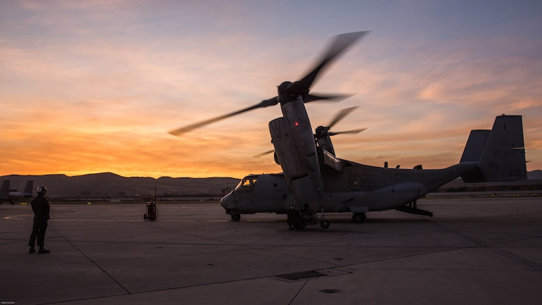 """Marines with Marine Medium Tiltrotor Squadron 364 """"Purple Foxes,"""" conduct the post-operations check of an MV-22B Osprey aboard Marine Corps Air Station Camp Pendleton, Calif., April 5. Marines with VMM-364 and VMM-165 spent several hours conducting division confined area landings in Southern California to build and maintain the proficiency of the pilots and air crew."""