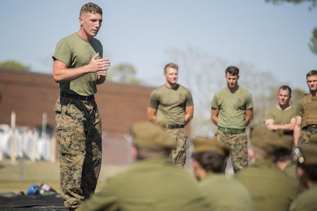 Sgt. John Taylor, a black belt Martial Arts Instructor with 2nd Transportation Support Battalion, 2nd Marine Logistics Group, leads Canadian cadets in a guided discussion about the Marine Corps' core values following a Marine Corps Martial Arts Program demonstration at Camp Lejeune, N.C., March 16, 2016.  A total of 46 cadets with the Argyll and Sutherland Highlanders of Canada Regimental Cadet Corps visited the base and multiple units as part of an educational tour to better understand how foreign militaries function.