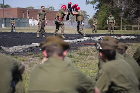 Marines with 2nd Marine Logistics Group show the intensity behind trench warfare by conducting a pugil sticks scrimmage at Camp Lejeune, N.C., March 16, 2016. A total of 46 cadets with the Argyll and Sutherland Highlanders of Canada Regimental Cadet Corps visited the base and multiple units as part of an educational tour to better understand how foreign militaries function.
