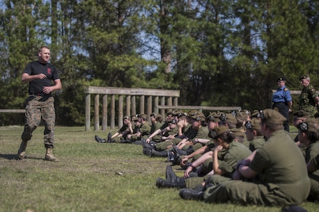 Staff Sgt. Chase Carson, a Martial Arts Instructor Trainer with Combat Logistics Battalion 6, 2nd Marine Logistics Group, motivates Canadian cadets before giving a demonstration of the Marine Corps Martial Arts Program at Camp Lejeune, N.C., March 16, 2016. A total of 46 cadets with the Argyll and Sutherland Highlanders of Canada Regimental Cadet Corps visited the base and multiple units as part of an educational tour to better understand how foreign militaries function.